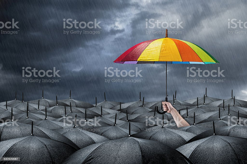 rainbow umbrella concept stock photo
