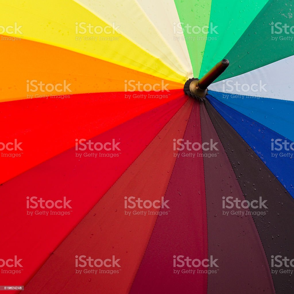 Rainbow umbrella with rain drops stock photo