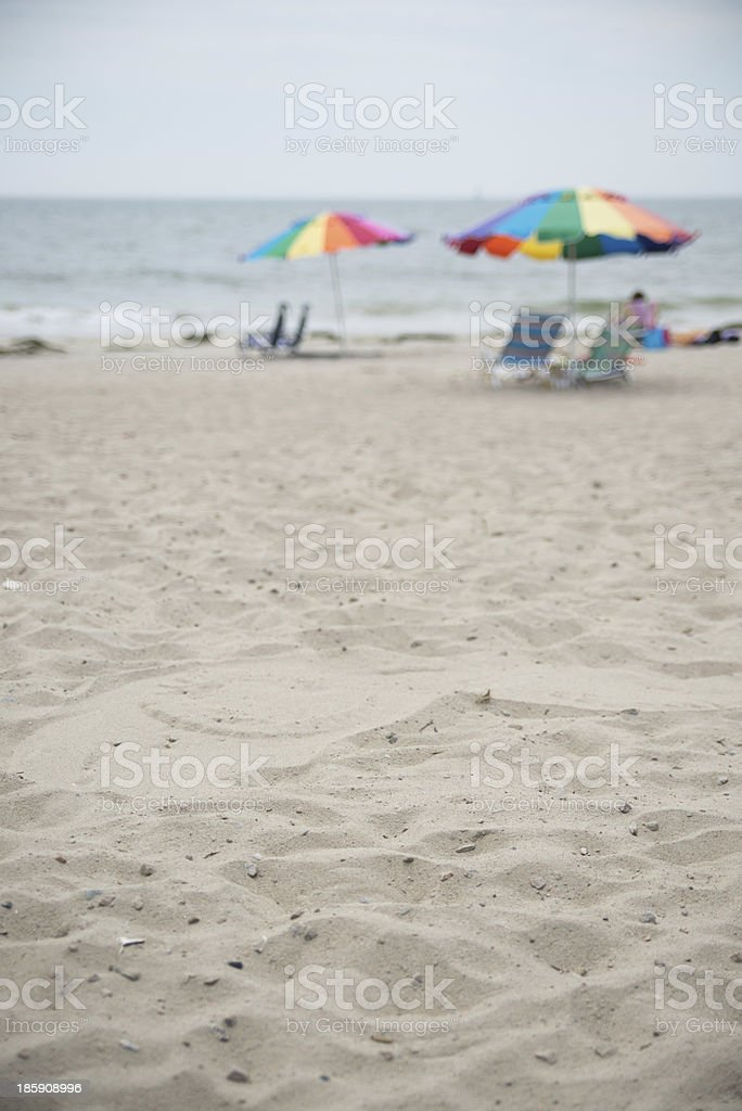 rainbow umbrellas on a peaceful beach royalty-free stock photo