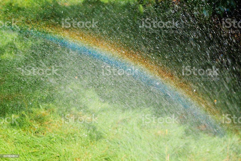 rainbow with rain stock photo