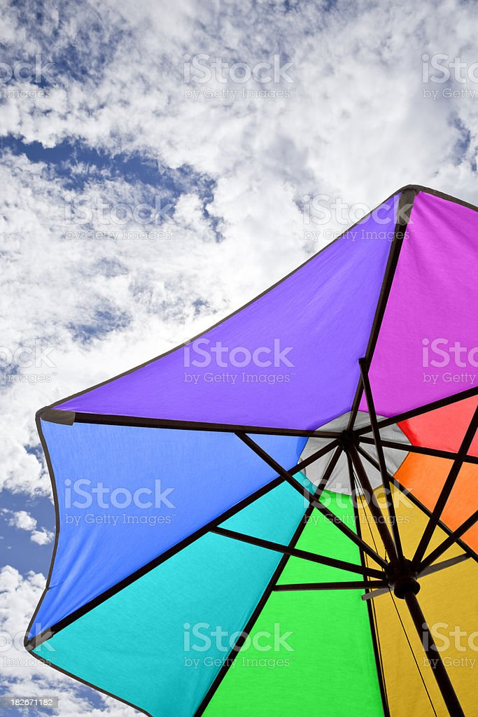 Rainbow-colored Beach Umbrella and Sky royalty-free stock photo