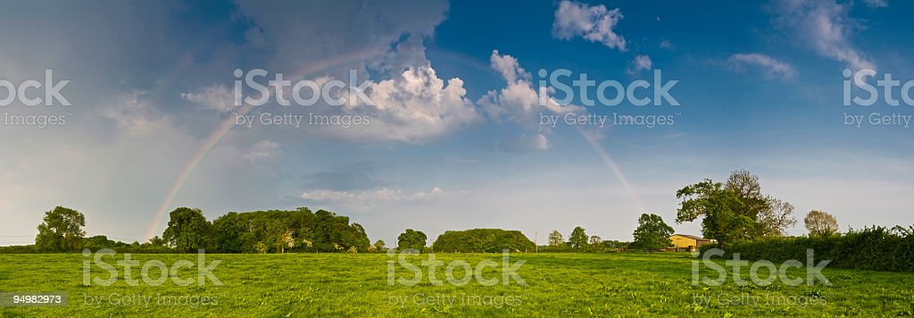 Rainbows dramatic cloudscape royalty-free stock photo