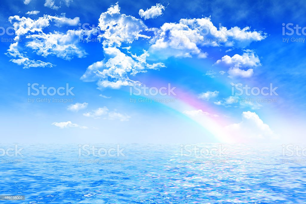 rainbows on cloudy sky over ocean, stock photo