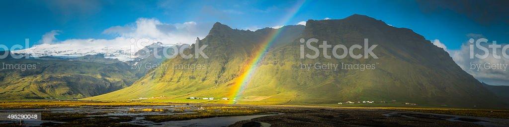 Rainbows rivers rugged mountain peaks panorama Arctic farms glaciers Iceland stock photo