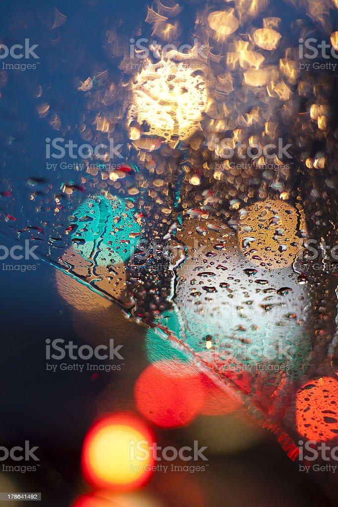 Raindrops and traffic lights stock photo