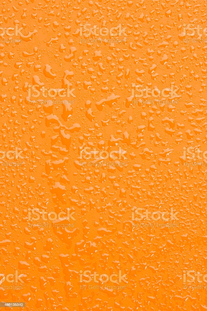 Raindrops background     Orange surface covered with water drops condensation texture stock photo
