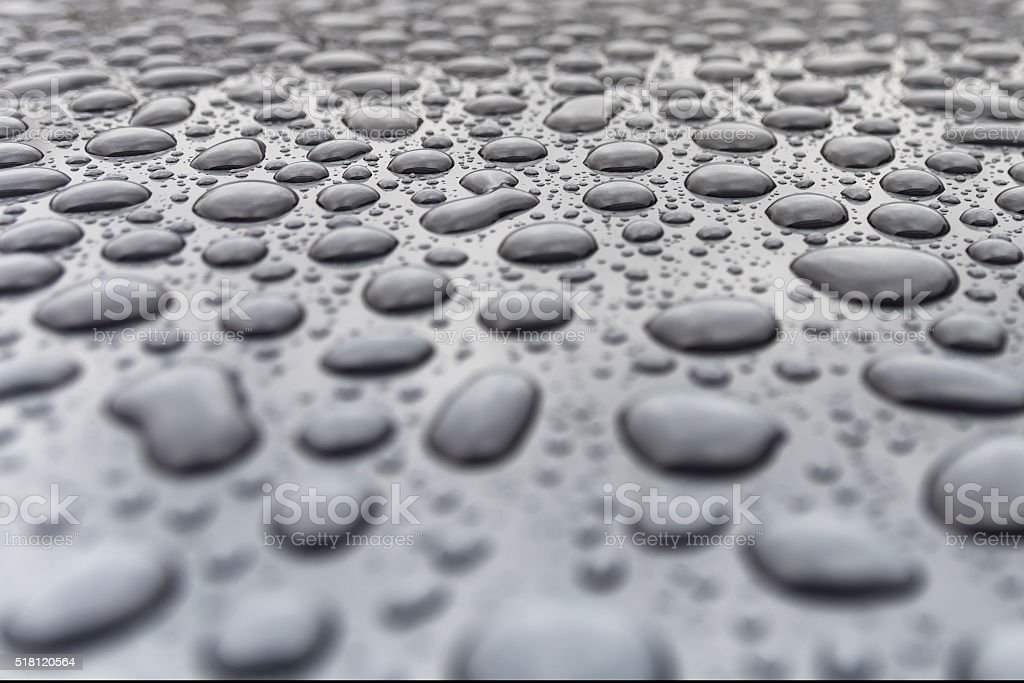 Raindrops on a car bonnet stock photo