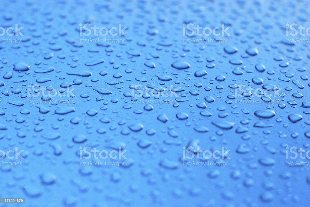 raindrops on blue royalty-free stock photo