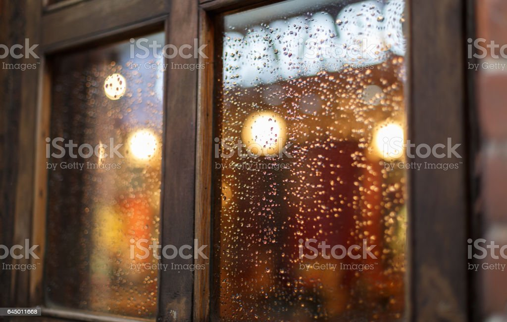 Raindrops on the color window stock photo