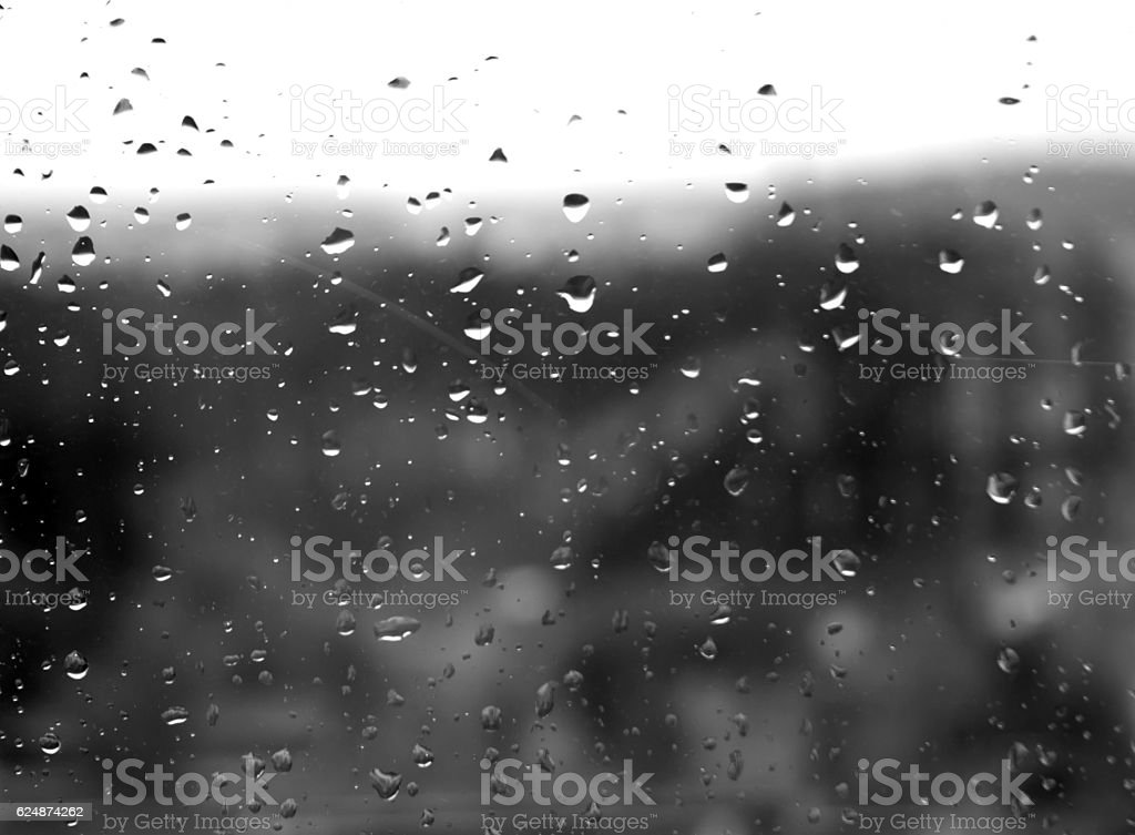 Raindrops on window in black and white. stock photo