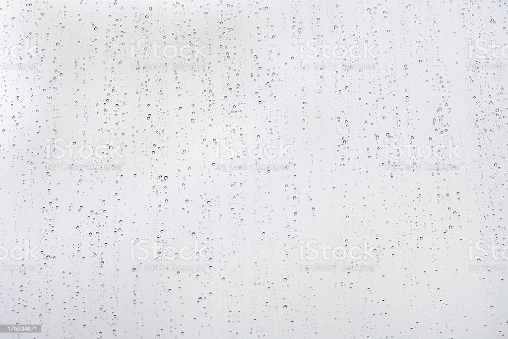 Raindrops on window pane stock photo