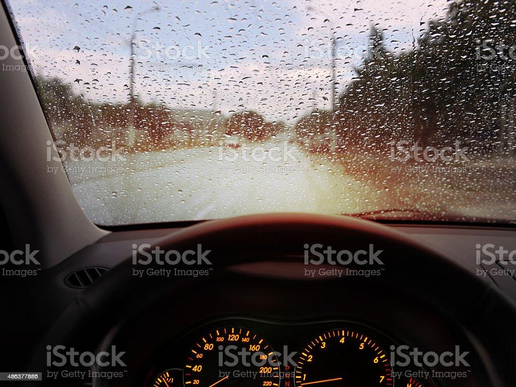 raindrops on windshield stock photo