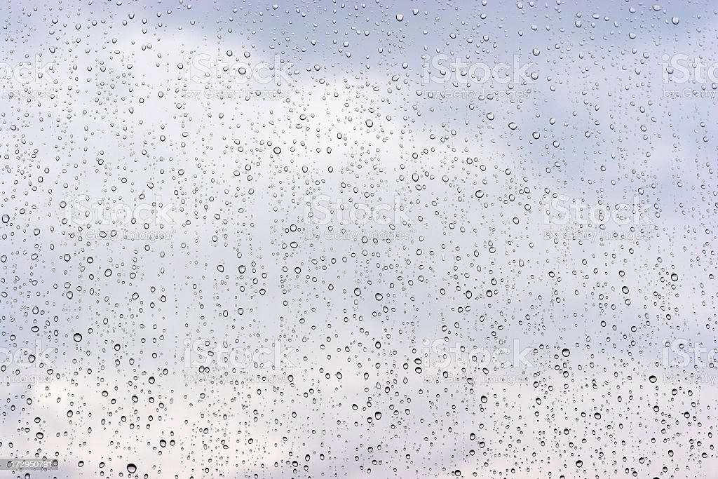 Raindrops rolling down a glass window royalty-free stock photo