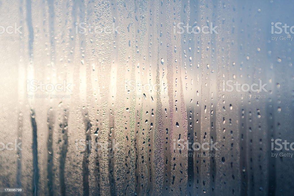 Raindrops streaking down a window royalty-free stock photo