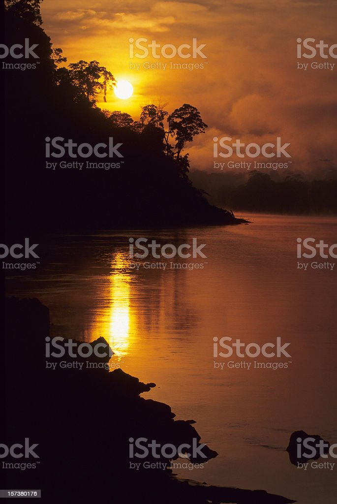 Rainforest sunrise on the Tambopota River royalty-free stock photo