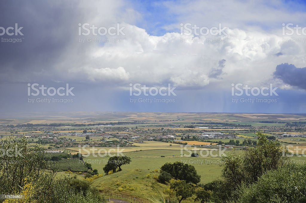 Raining above fertile valley royalty-free stock photo