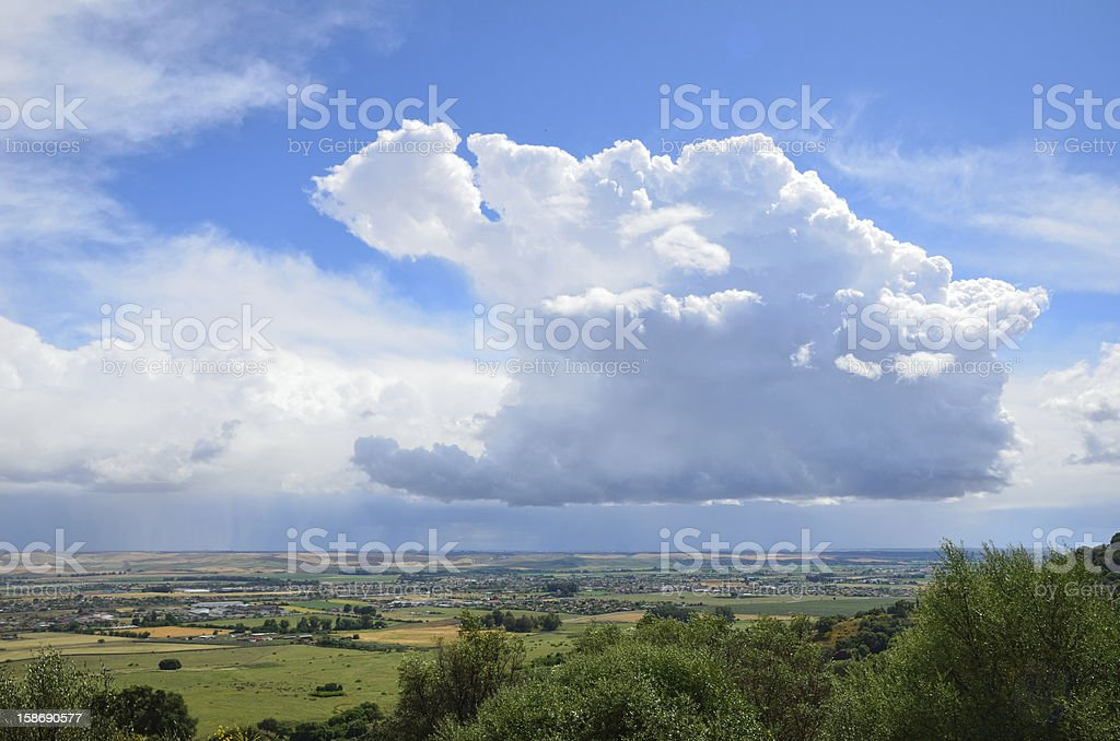 Raining above the fertile valley stock photo