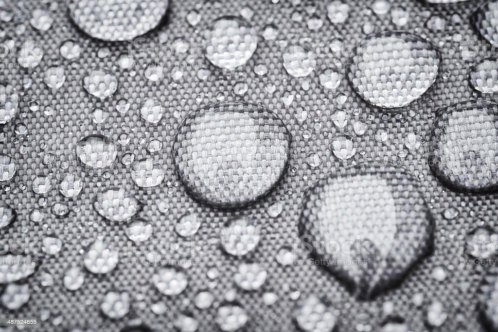 rainproof cloth with raindrops stock photo