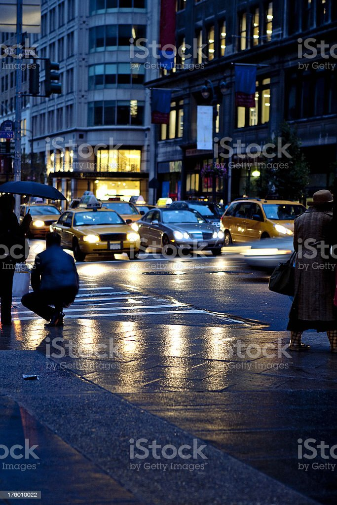 busy life in New York City. Long exposure. Focus in foreground lady...