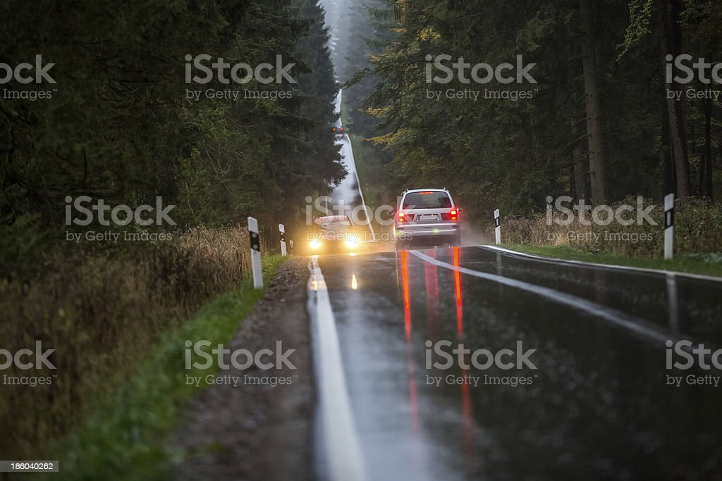 rainy countryside street with traffic
