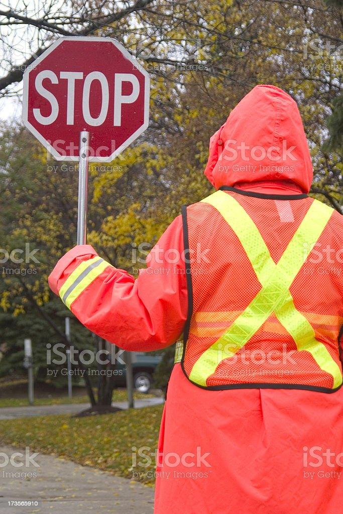 Rainy Day Crossing Guard royalty-free stock photo