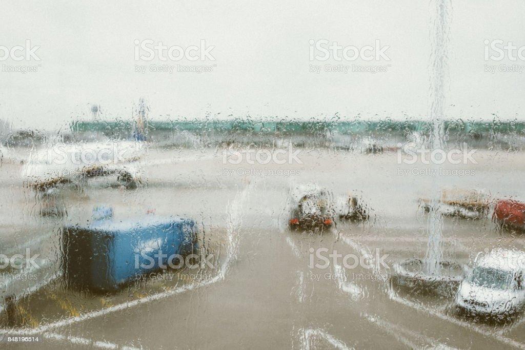 Raindrops on airport window