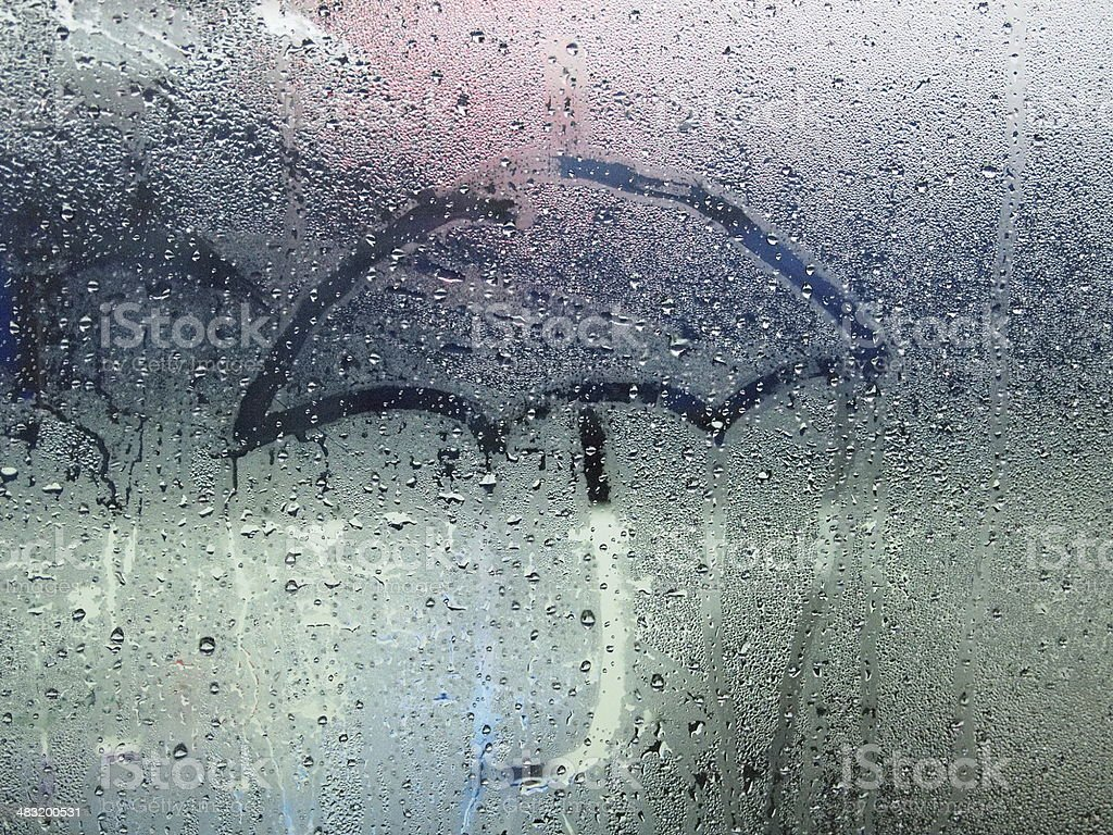 Rainy day, water droplets on the window stock photo