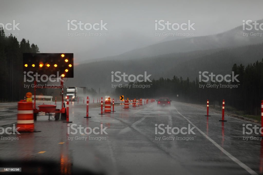 Rainy Driving with Roadsigns stock photo