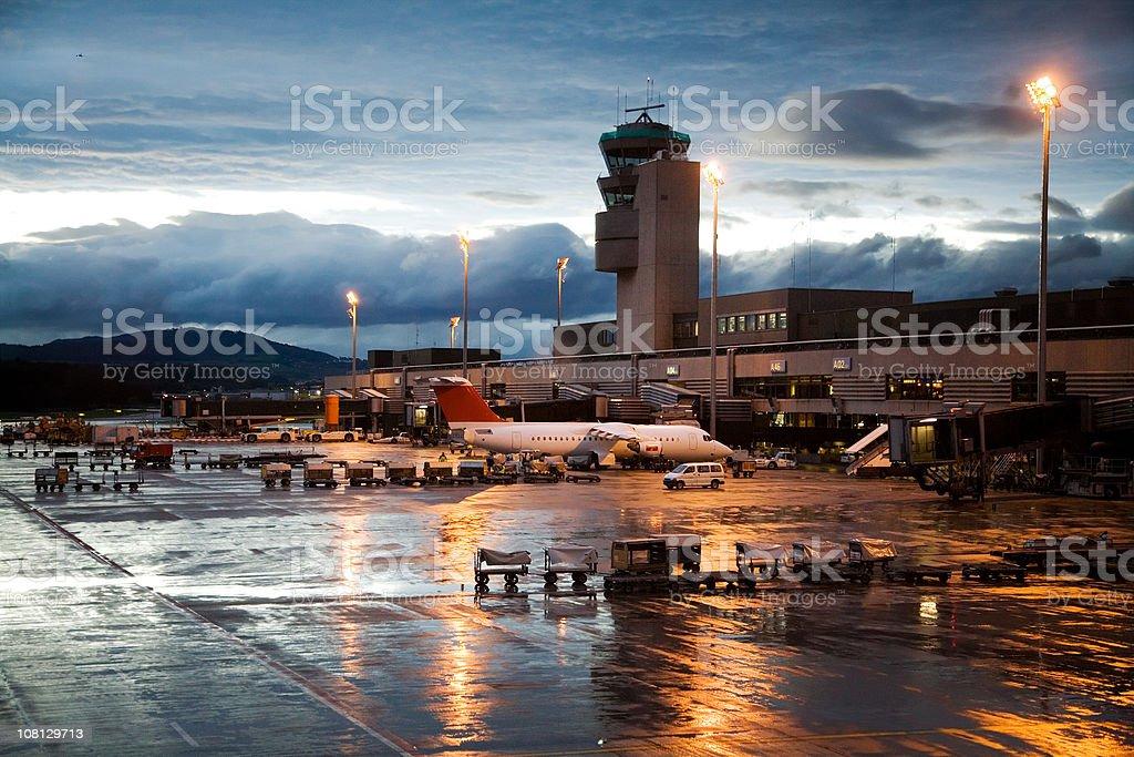 Rainy Evening at Airport Terminal and Hangar stock photo