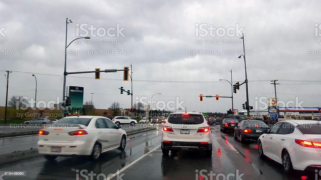Rainy Evening With Cars At The Traffic Lights stock photo