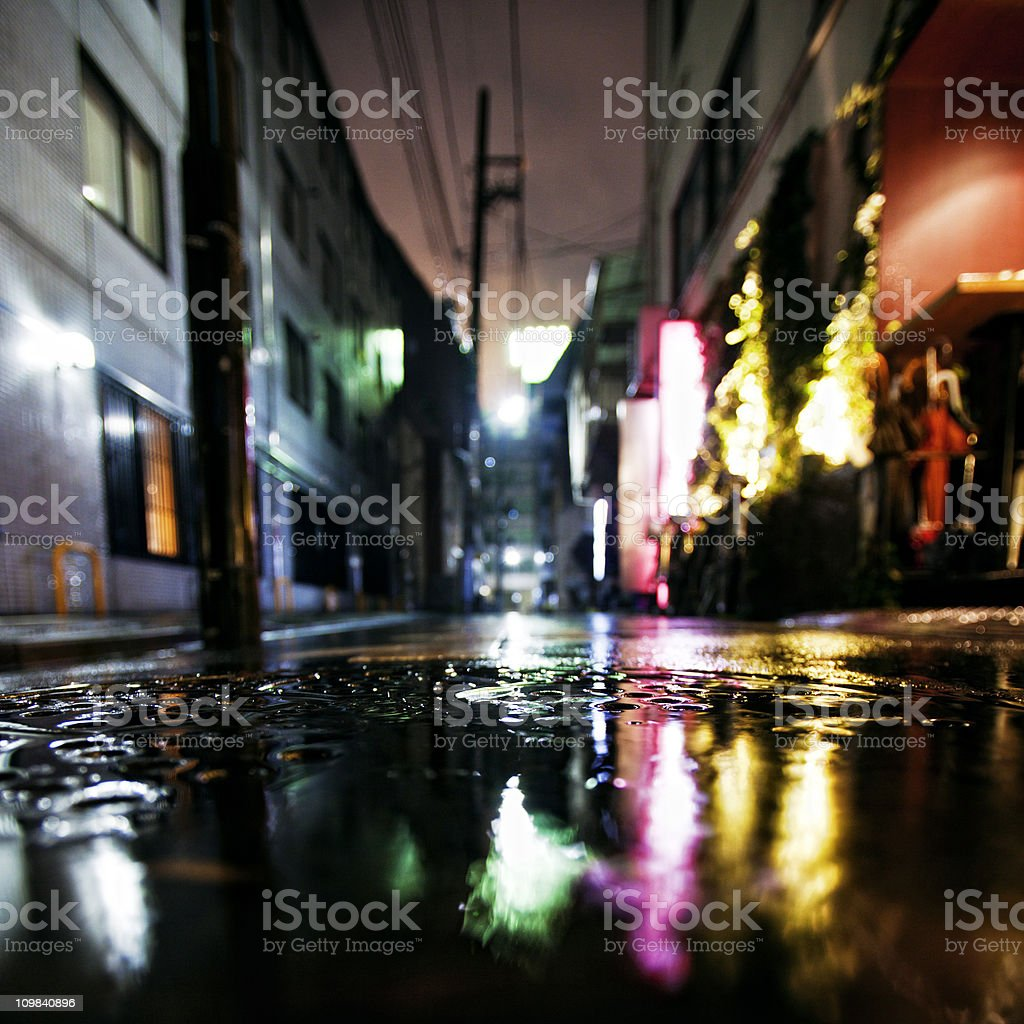rainy night in big city stock photo