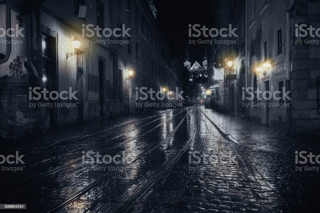 Rainy night in old European city stock photo