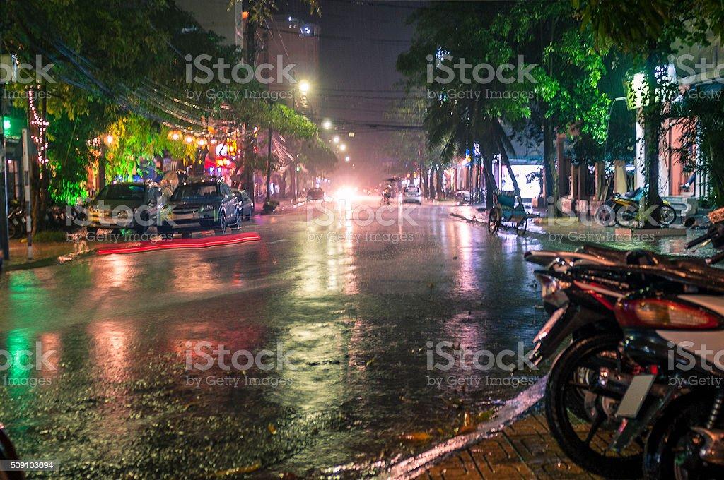 Rainy Nighttime Street Scene In Nha Trang, Vietnam stock photo