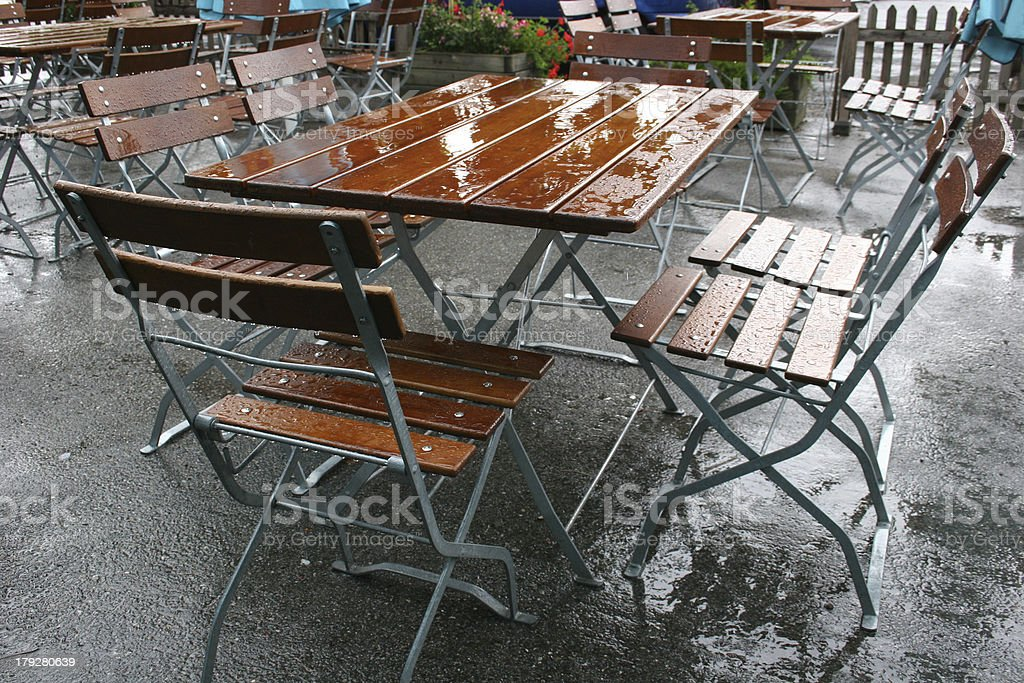 Rainy summer in a german beer garden royalty-free stock photo