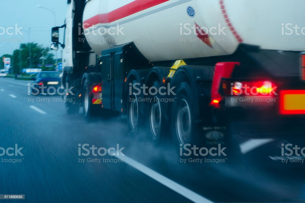 Truck driving on a wet road in the rain