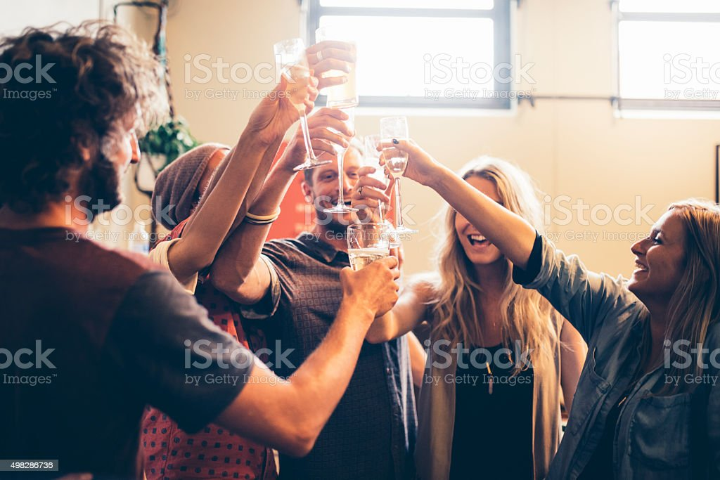 Raise your glass! stock photo