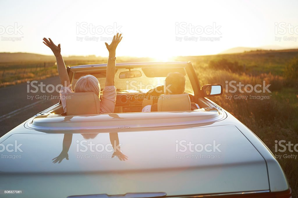 Raise your hands to the sun stock photo