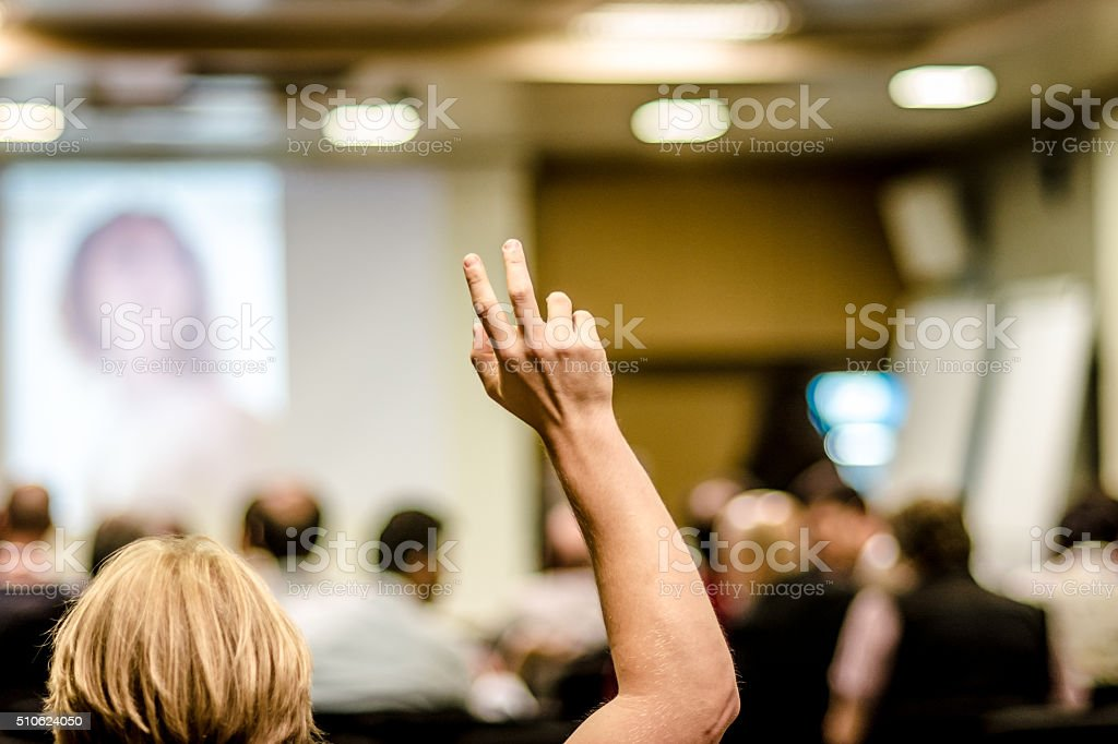 Raised fingers in classroom stock photo