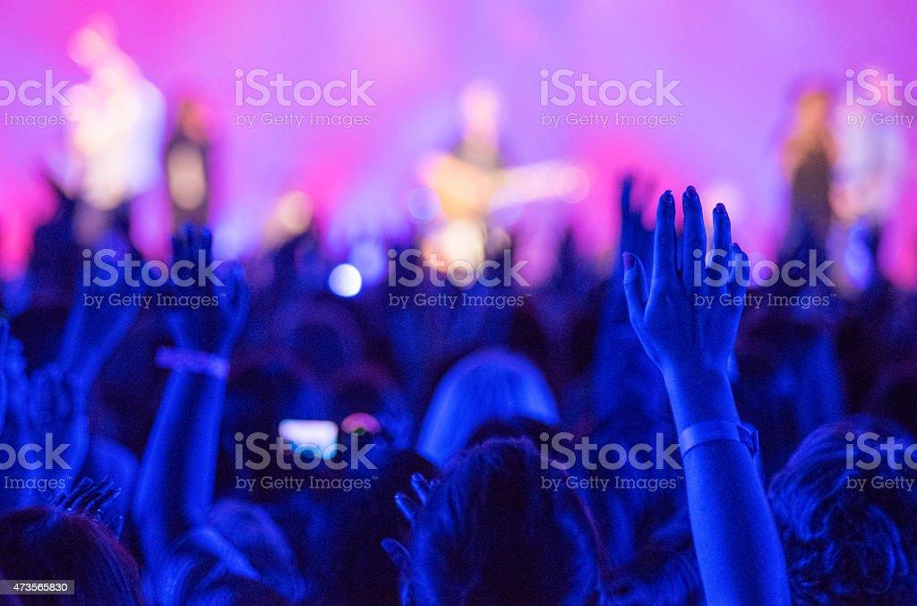 Raised Hands Concert stock photo