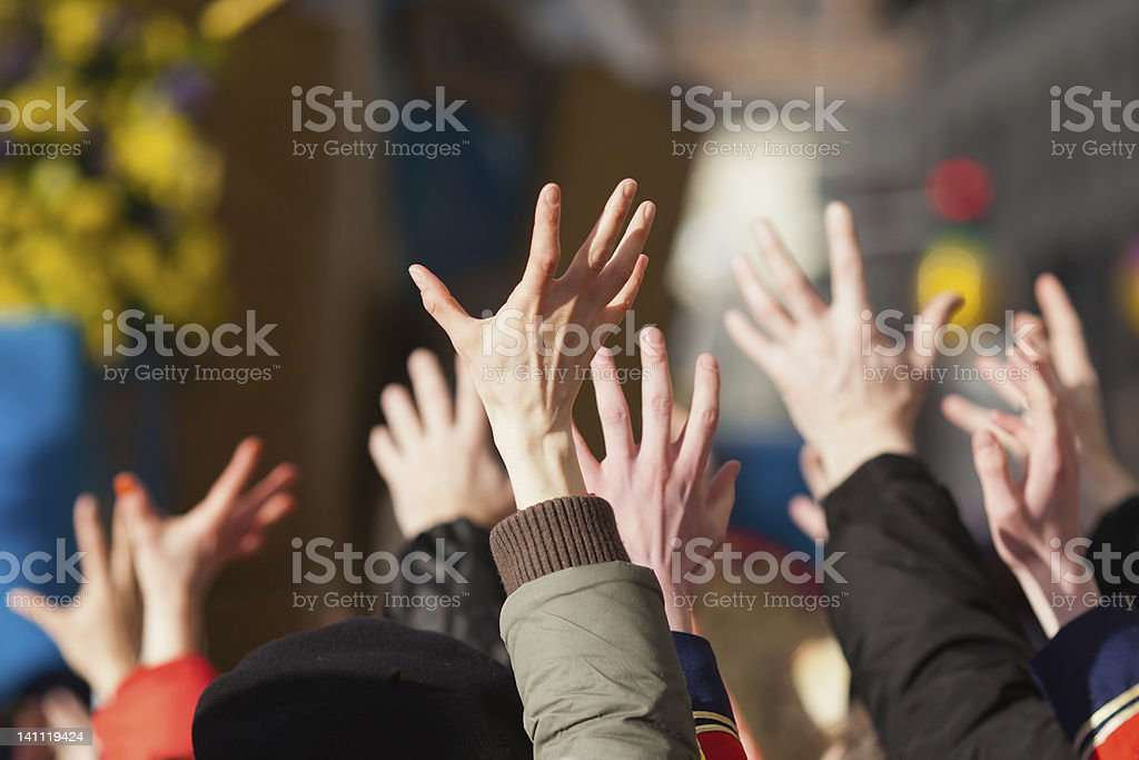 raised hands from a crowd of people royalty-free stock photo