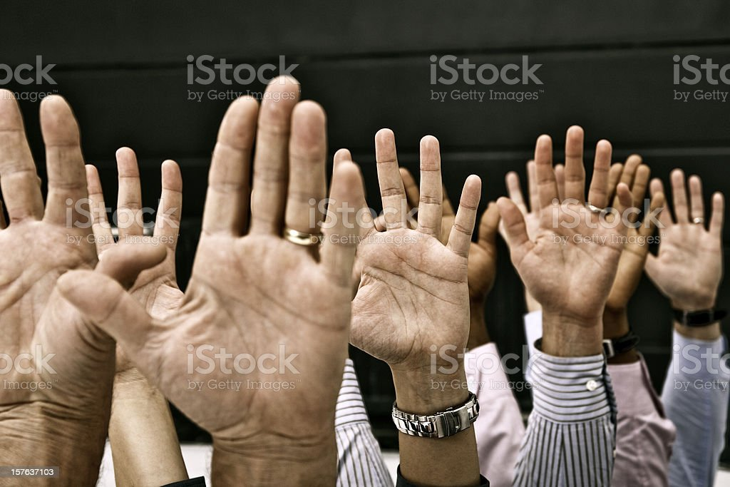 Raised hands of male and female participants of the meeting royalty-free stock photo