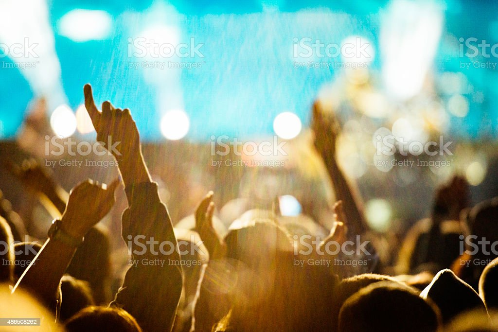 Raised hands stock photo