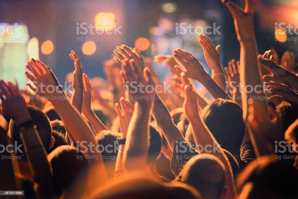 Raised hands stock photo