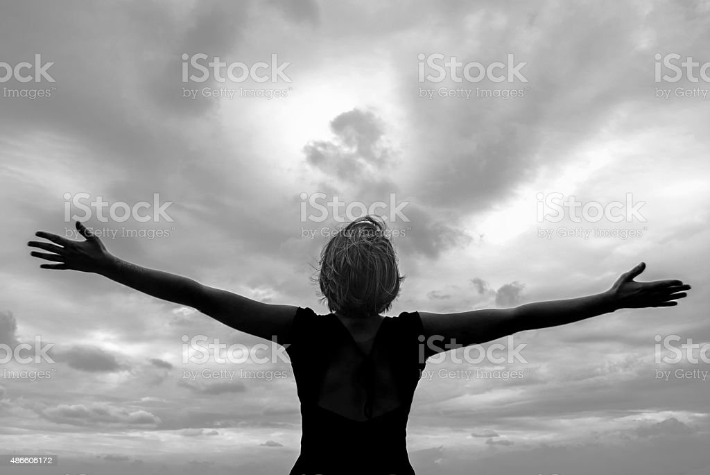 Raised Hands To The Sky stock photo