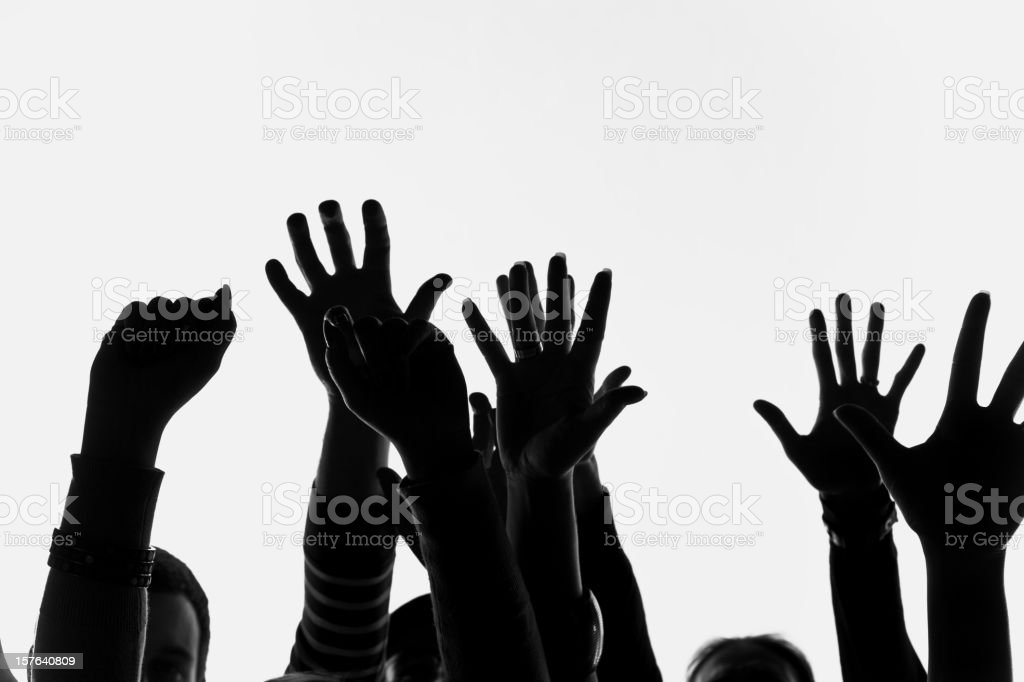 Raised human hands royalty-free stock photo