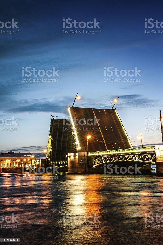 Raised Palace Bridge in St Petersburg at Night stock photo