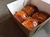 Raisin buns to go in cardboard box (hot cross buns)