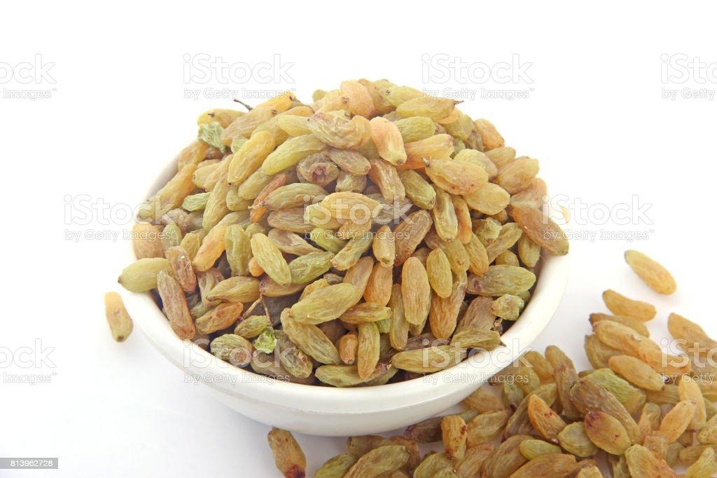 raisin in white bowl stock photo