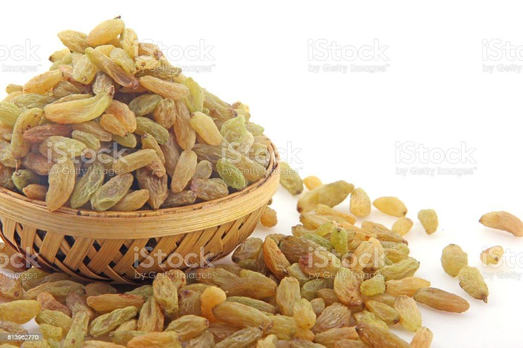 Raisin in wooden bowl stock photo