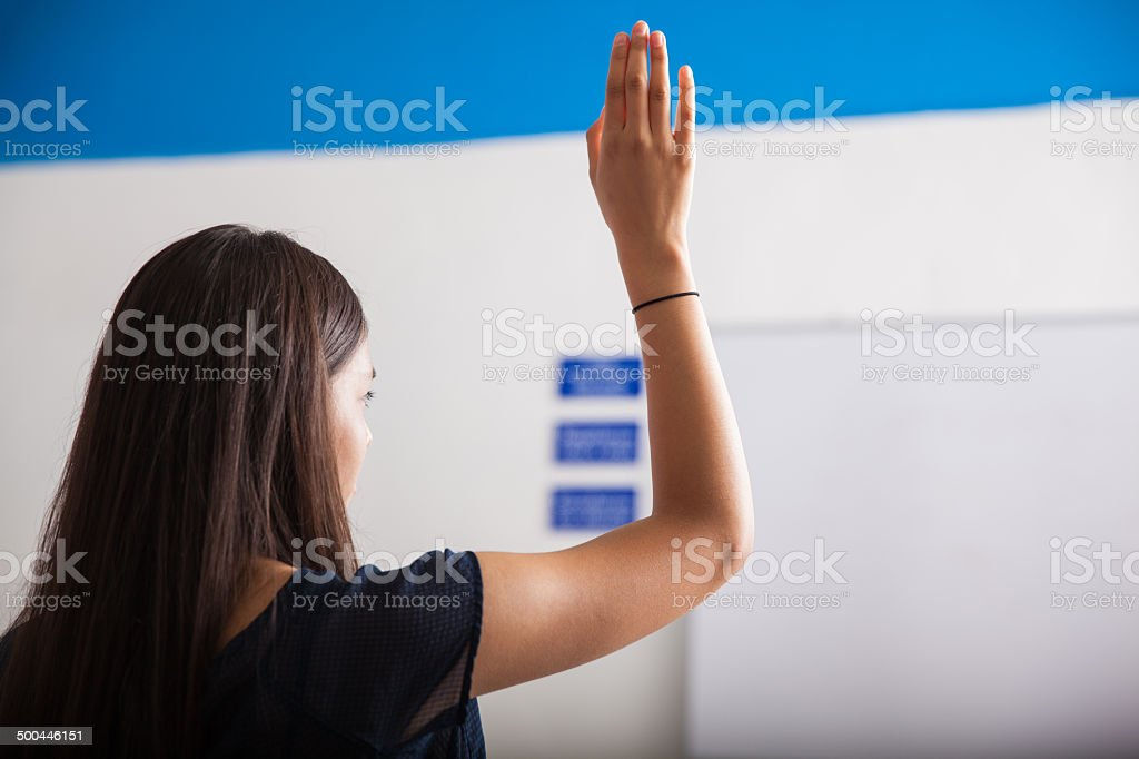 Raising a hand in class stock photo
